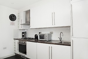 white kitchen with microwave and stove